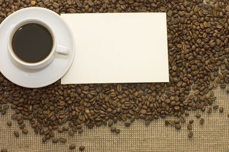 Cup from coffee on coffee grains photo