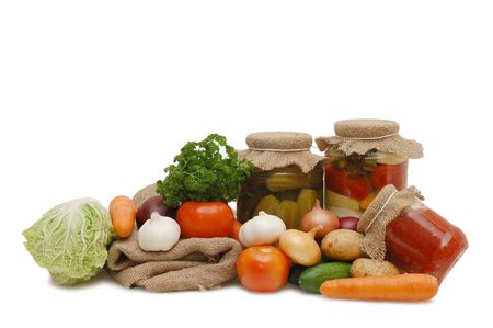 Fresh and tinned vegetables isolated on white  photo