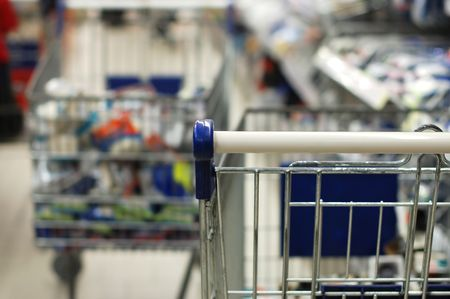 Shopping cart moving through market Stock Photo - 5960615