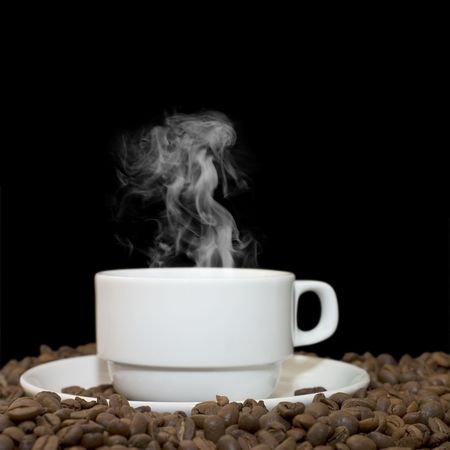 excite: Cup from coffee on coffee grains Stock Photo