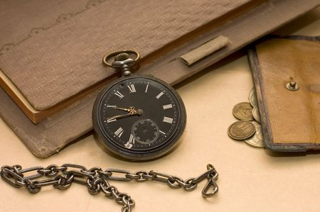The old book, old watch and money   photo