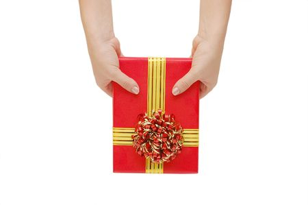 Box with a gift in a hand photo