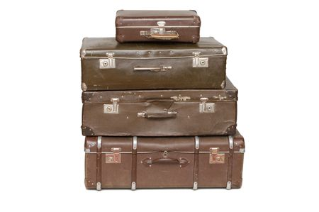 suitcases: Heap of old suitcases isolated on white