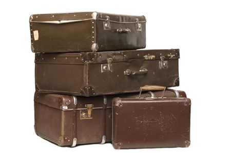 packing suitcase: Heap of old suitcases isolated on white Stock Photo