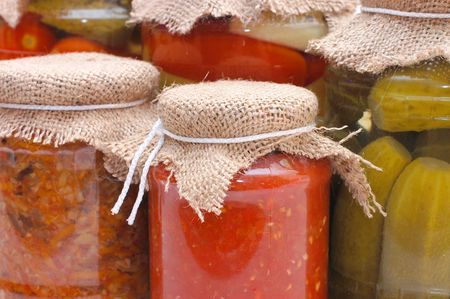 tinned: Glass jars with tinned vegetables Stock Photo