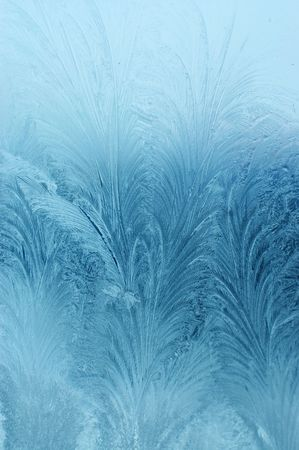 frosty natural pattern on winter window   photo