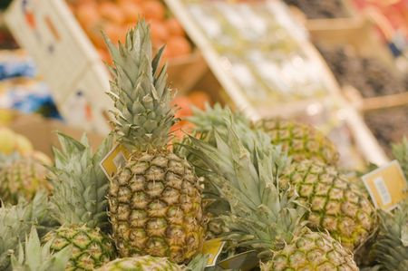 Shelf with pineapples in a supermarket Stock Photo - 6200716