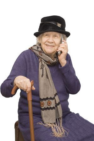 grandmother talking with a mobile phone   photo