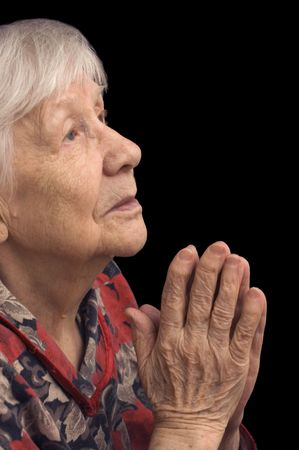 The old woman prays on a black photo