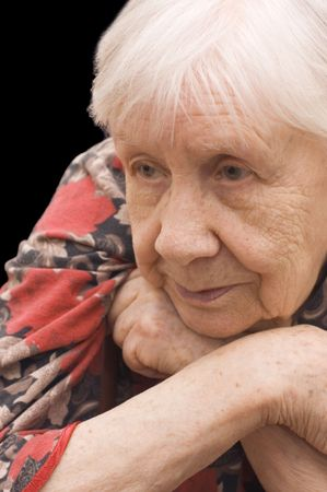 The sad old woman on the black Stock Photo - 6245747