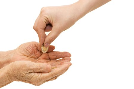 pauper: Young and old hand with a coin Stock Photo