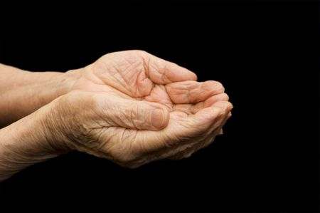 The old hands begging on the black Stock Photo - 6290101