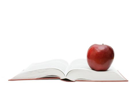 Red apple on the open book photo