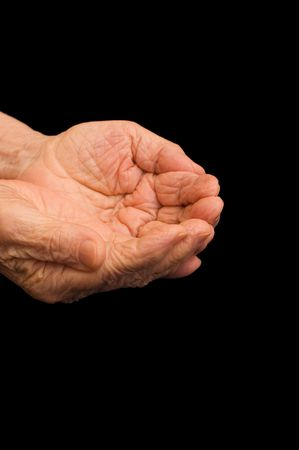 The old hands begging on the black Stock Photo - 6337060