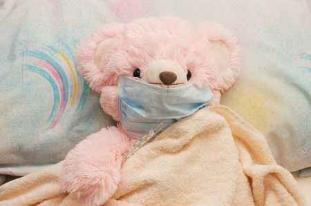 pink bear is ill in a bed photo
