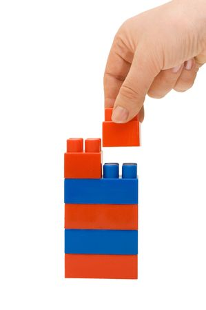 Hand and toy tower isolated on white background   photo
