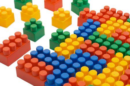 Multi-colored plastic blocks on white    photo