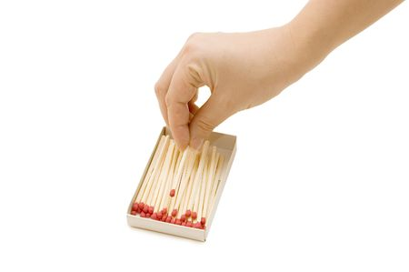 burned out: hand takes out a match from a matchbox Stock Photo