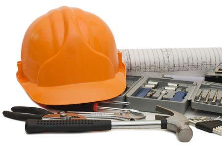 hard hat:  Orange helmet and different tools isolated