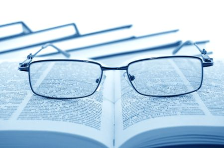 paragraph: Eyeglasses on books