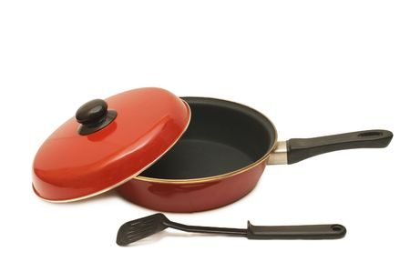Red frying pan isolated on white background photo