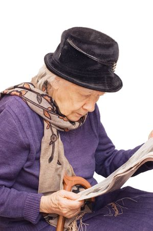 The old lady reads the newspaper photo