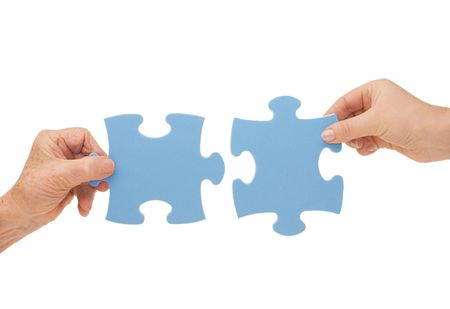 Hands and puzzle, isolated on white background Stock Photo - 6431688
