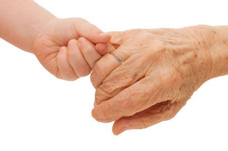 senior adult: Old and children hands on a white