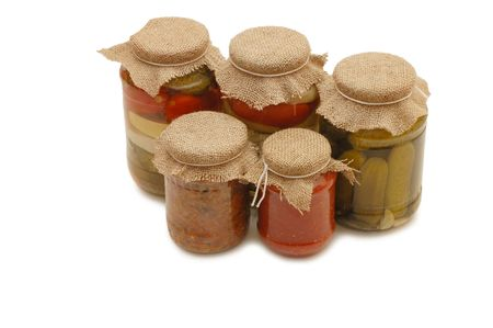 tinned: Glass jars with tinned vegetables isolated