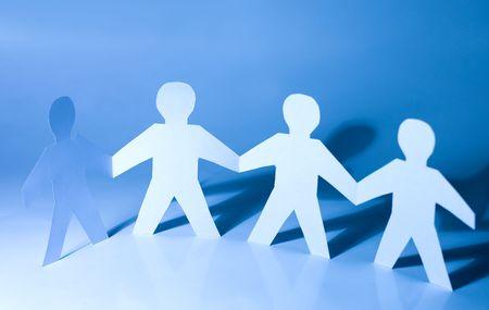 cooperation: Paper little men holding hands