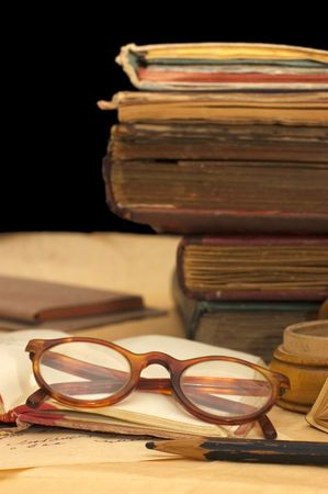Pile of old books and different things Stock Photo - 6515038