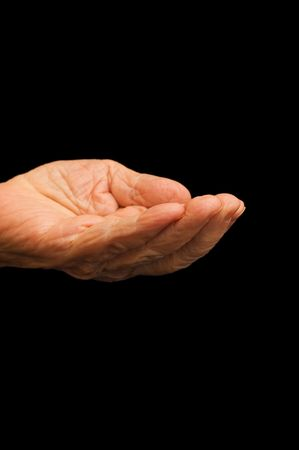 The old hand begging on the black Stock Photo - 6515082