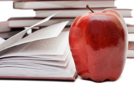 Stack of books and apple  photo