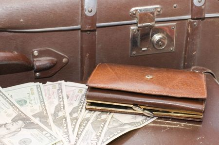 lays: Money lays on an old suitcase Stock Photo
