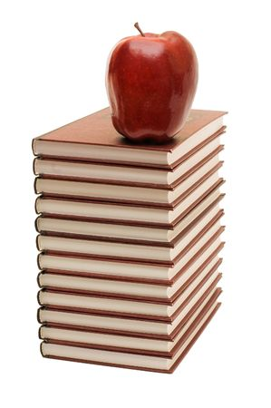 Stack of books and apple isolated photo