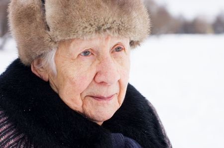Portrait of the old woman in the winter  photo