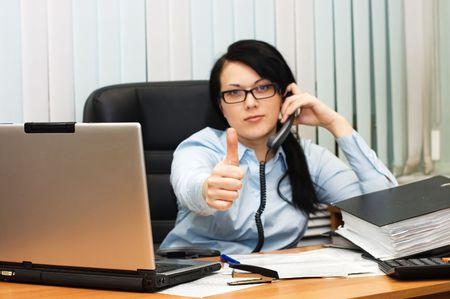 young girl at office behind a table Stock Photo - 6611733