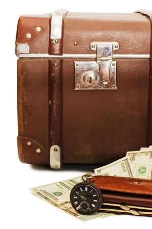 Money lays on an old suitcase photo
