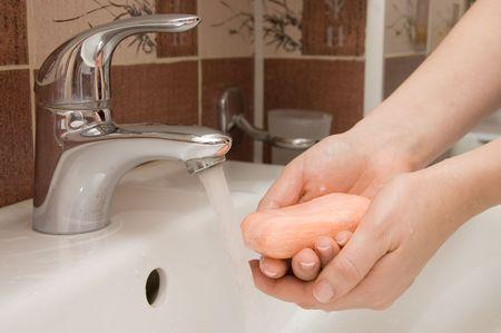 sudsy: woman washing hand under running
