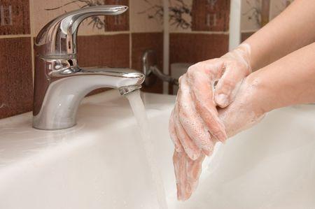 woman washing hand under running Stock Photo - 6629436
