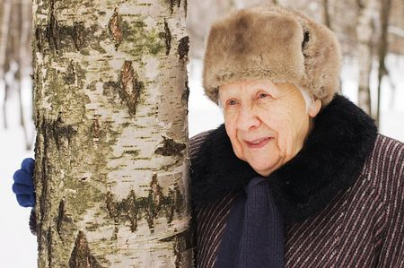 ice age: Portrait of the old woman in the winter