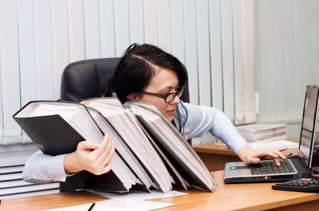 young girl at office behind a table photo