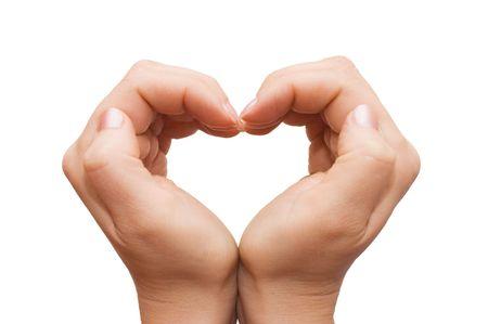 corazon en la mano: las manos formando un coraz�n sobre fondo blanco
