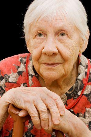 sad old woman: La anciana triste sobre el negro   Foto de archivo