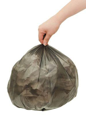 Black garbage bag In a female hand photo