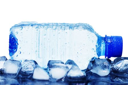 cold mineral water bottle with ice cubes photo