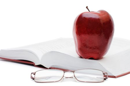 Red apple and glasses on the book     photo