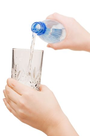 The girl pours water in a glass photo