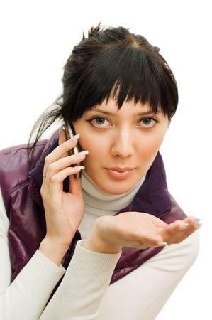 speaks: girl speaks by phone isolated on white