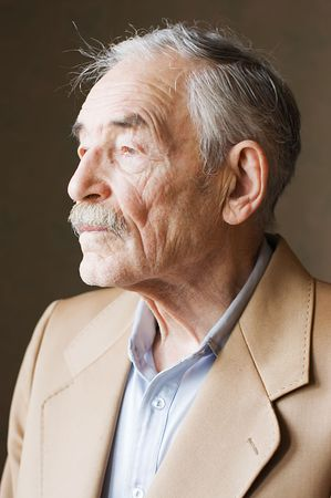 profile face: Old man with moustaches in a jacket